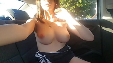 Nude cutie masturbates at the beach in back seat of her car