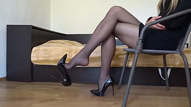 Pantyhose and heels dangle
