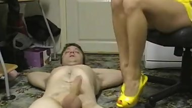 Russian brunette in yellow dress ballbusting footjob