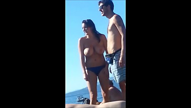 Big Tit Brunette Topless on the Beach