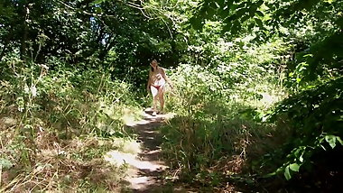 Sexy MILF's Naughty Summertime Stroll in the Woods