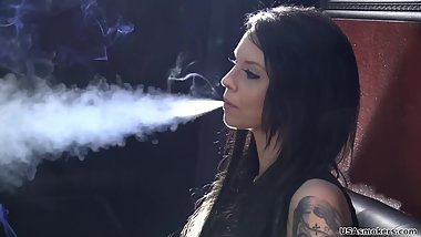 Elle inhales deeply and keeps the smoke in her lungs for a long time (2)