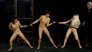 Tug of war between three slave girls