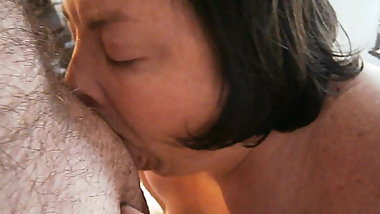 Deepthroating cock while riding the vibrator