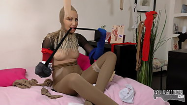 This bitch can't get enough nylon on her body