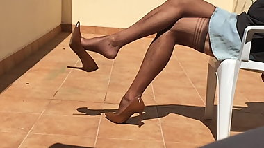 Dangling by my new brown Stiletto Heels